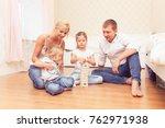 cheerful family spending time... | Shutterstock . vector #762971938