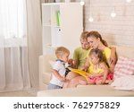 mom reading a book for children.... | Shutterstock . vector #762975829