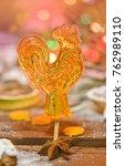 sweet cock on wooden background.... | Shutterstock . vector #762989110