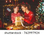 a happy family mother and child ... | Shutterstock . vector #762997924