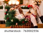Woman Hand Arranging Christmas...