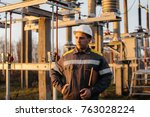 the energy engineer inspects... | Shutterstock . vector #763028224