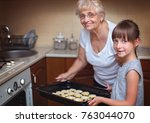 grandmother with granddaughter... | Shutterstock . vector #763044070