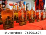 Small photo of Whiskey prepared by locals on an island off the coast of Laos, at the Golden Triangle Special Economic Zone Chinatown. These brews contain either a previously live cobra, scorpion, or tiger genitalia.