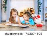 two kids read a book. concept... | Shutterstock . vector #763074508