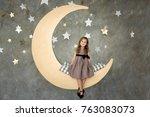 little girl in gray dress is...   Shutterstock . vector #763083073