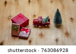 christmas gifts on wooden table ... | Shutterstock . vector #763086928