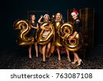group of girlfriends in santa... | Shutterstock . vector #763087108