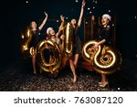girls in red christmas hats... | Shutterstock . vector #763087120