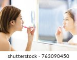young woman brushing teeth and... | Shutterstock . vector #763090450
