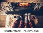 feet in woollen socks by the... | Shutterstock . vector #763093558