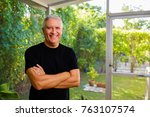 handsome middle age man in a... | Shutterstock . vector #763107574
