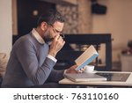 senior old man reading a book...   Shutterstock . vector #763110160