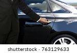driver hand opening car door | Shutterstock . vector #763129633