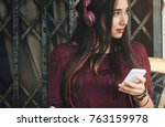 woman listening to music | Shutterstock . vector #763159978
