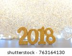 shiny 2018 numbers with lights... | Shutterstock . vector #763164130