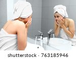Young Woman Washing Her Face...