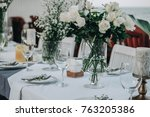 wedding table decorated with... | Shutterstock . vector #763205386