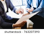 business partners discussing... | Shutterstock . vector #763207393