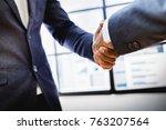 businessman shaking hands to... | Shutterstock . vector #763207564