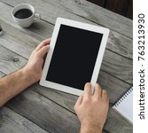 digital tablet in man hand... | Shutterstock . vector #763213930