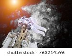 astronaut floating in outer... | Shutterstock . vector #763214596