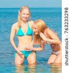 beauties joy on a beach  | Shutterstock . vector #763233298