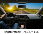 the man inside the car is... | Shutterstock . vector #763274116