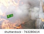 emergency exit and fire in the... | Shutterstock . vector #763280614