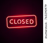 glowing neon closed sign with...   Shutterstock .eps vector #763290979