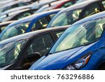 Car Industry Concept. Brand New Cars in Stock. Transportation Business Theme. - stock photo