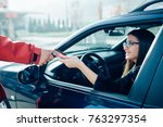 beautiful girl poured fuel into ... | Shutterstock . vector #763297354