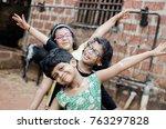 kids doing flying gesture | Shutterstock . vector #763297828