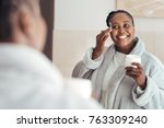 smiling young african woman...   Shutterstock . vector #763309240