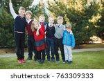 happy school children in... | Shutterstock . vector #763309333