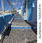 Small photo of The path way to the cable car connecting Thera to the old port on the coastline of Santorini Island, Greece.