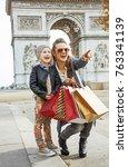 stylish autumn in paris. happy... | Shutterstock . vector #763341139