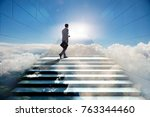 businessman climbing up... | Shutterstock . vector #763344460
