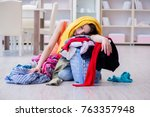 stressed woman doing laundry at ... | Shutterstock . vector #763357948