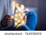 young female hands holding... | Shutterstock . vector #763358353