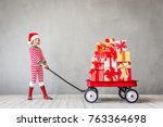 happy child with christmas gift.... | Shutterstock . vector #763364698