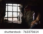 young woman captive or prisoner ... | Shutterstock . vector #763370614