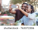 smiling young african couple... | Shutterstock . vector #763372306