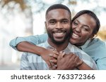 smiling young african woman... | Shutterstock . vector #763372366