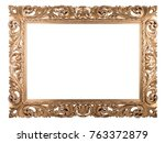Small photo of Wooden golden frame with rich woodcut ornament, isolated on white