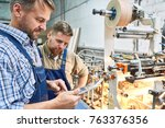 portrait of two workers using... | Shutterstock . vector #763376356