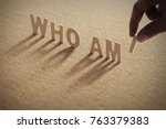 who am i wood word on... | Shutterstock . vector #763379383