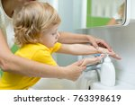 mother and little son washing... | Shutterstock . vector #763398619