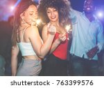 young friends dancing with... | Shutterstock . vector #763399576