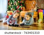 two beautiful little girls lie... | Shutterstock . vector #763401310